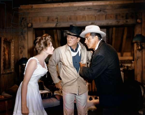 Capucine, John Wayne And Stewart Granger.