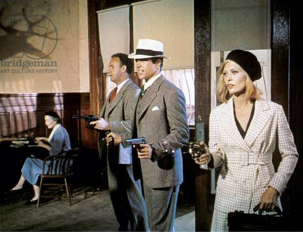 Medium Shot In Bank Of Gene Hackman As Buck Barrow, Warren Beatty As Clyde Barrow, Wearing Hat, And Faye Dunaway As Bonnie Parker, All Holding Guns/Pistols; Woman Seated In Background.