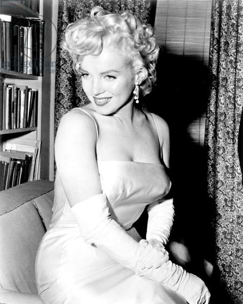American actress and singer Marilyn Monroe (1926 - 1962), during a party for the birth of the Marilyn Monroe Productions, 1955 (b/w photo)