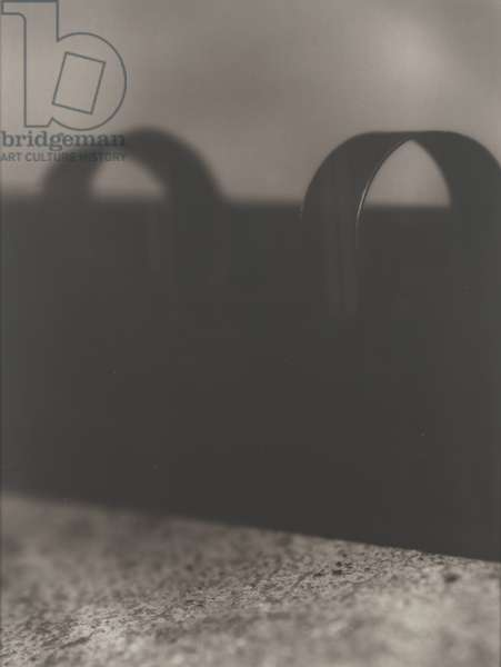 Untitled (weaving shuttle), 1995 (sepia-toned gelatin silver fiber print)