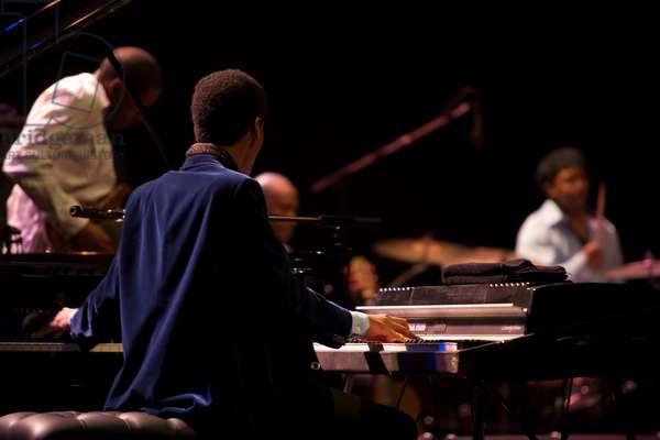 Jonathan Batiste playing piano (photo)