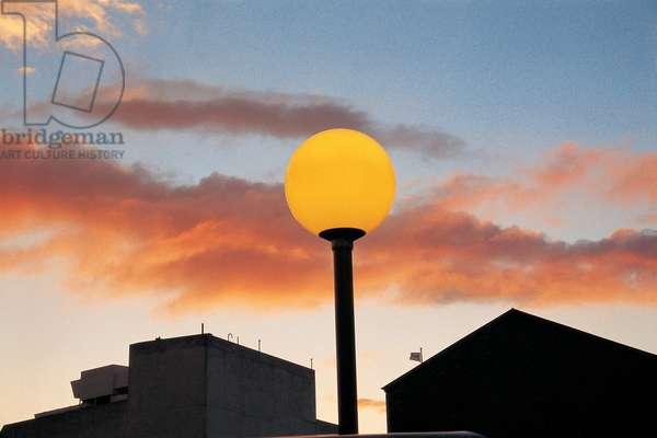 Late sunset on summer evening yellow street-light, Berne (photo)