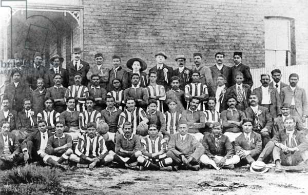 Mohandas Gandhi with a football team of passive resisters in South Africa, 1913 (b/w photo)