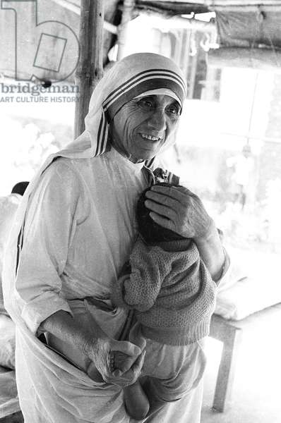 Mother Teresa with a baby (b/w photo)