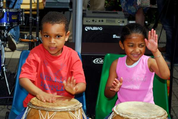 Infants playing the drums