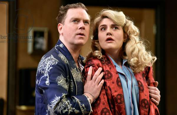 Rufus Hound (Playing Garry Essendine) and Lizzy Connolly (Playing Daphne Stillington) in a scene from Present Laughter by Noel Coward, Chichester Festival Theatre, Sussex, United Kingdom. Wednesday 25 April 2018.