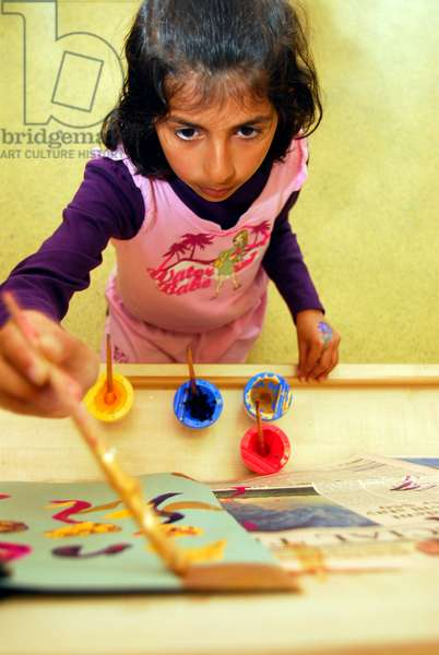 Infant school pupil painting