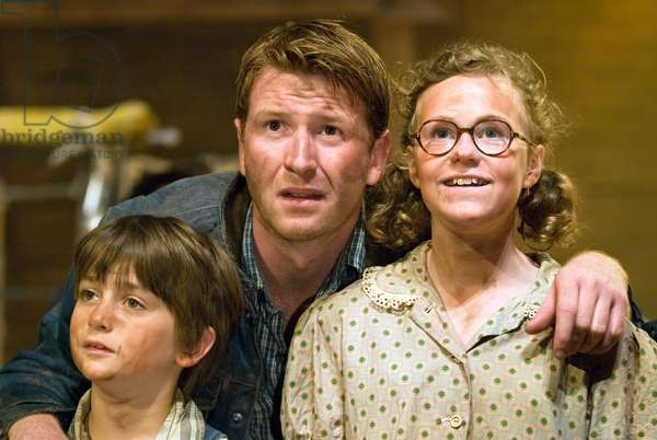 Left to right: Jude Loseby as Winfield Joad, Damian O'Hare as Tom Joad and Kassie Bull playing Ruthie Joad in The Grapes of Wrath by John Steinbeck, Chichester Festival Theatre, July 2009. Directed by Jonathan Church.