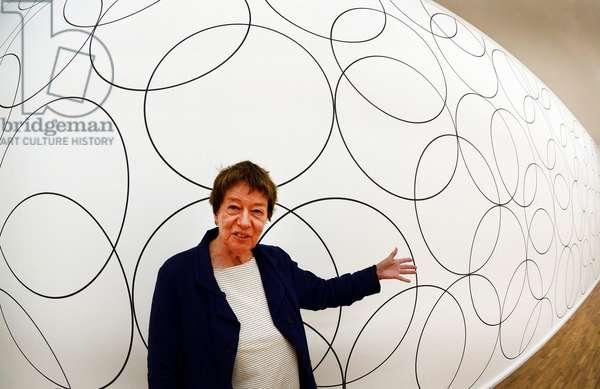"British artist Bridget Riley in front of her artwork ""Composition with Circles 8, 2012"", Siegen, 22nd June 2012 (photo)"
