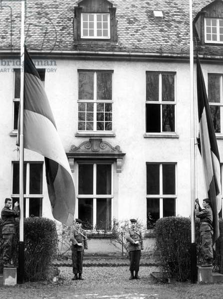 German and French national flags in front of French headquarters building in Tübingen