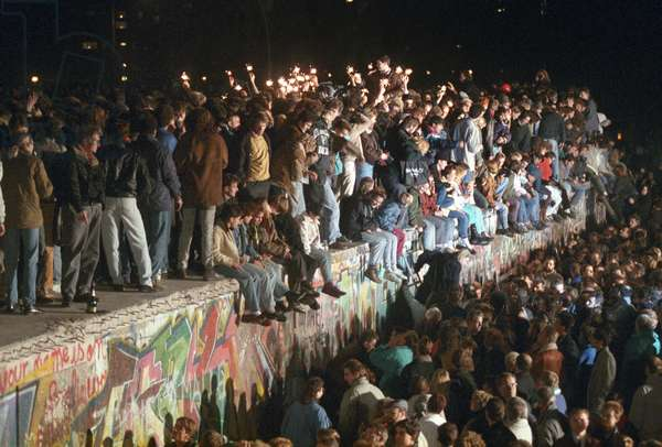 Fall of the wall in Berlin 1989 : Berliners and people from all over Germany celebrate with sparklers on the Berlin Wall on November 11th 1989. After the GDR leadership had opened some of border crossing points, millions of east Germans travelled to the west for short trips.