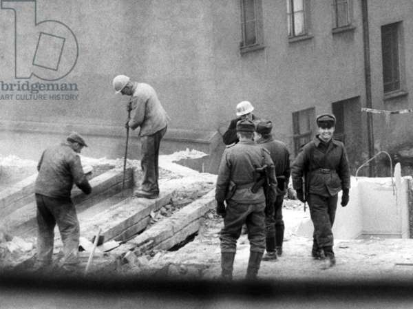 Border houses in East Berlin are torn down for the Wall