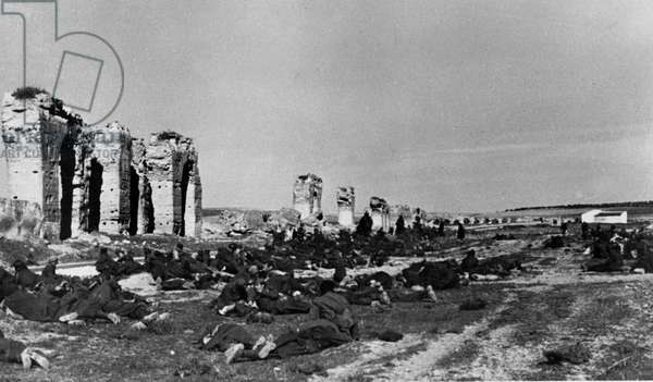 WWII - North African Campaign 1943 : The image from the Nazi Propaganda! depicts French prisoners fo war during a break at the aqueduct of Zaghouan on the way to a prisoner camp in Tunis, Tunisia, published on 5 February 1943. Photo: Berliner Verlag/Archiv