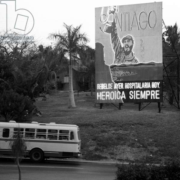 A poster with Fidel Castro in victory pose at a street in Santiago de Cuba, photographed on the 22nd of February in 1974