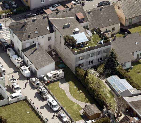 An aerial view of the house where a 42-year-old woman was held prisoner and...