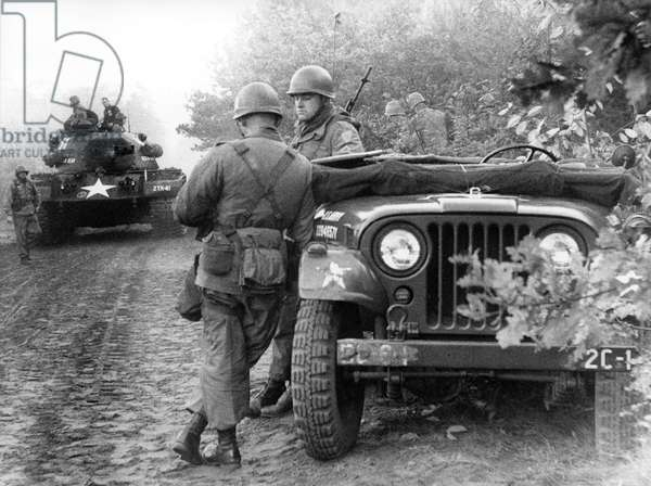 Tank and jeeps in manoeuvre of US army in Berlin Grunewald
