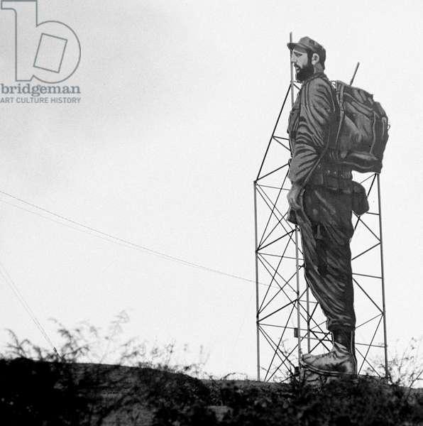 Historical Cuba - Santiago de Cuba 1974 - Propaganda : An over-sized figure of Fidel Castro at a hill near Santiago de Cuba on the 22nd of February in 1974. Photo: ddrbildarchiv.de / Klaus Morgenstern - GESPERRT FUeR BILDFUNK / blocked for picture transmission