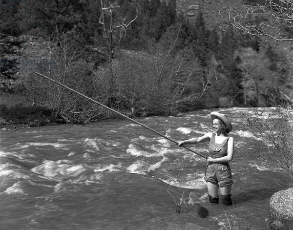 Girl fishing, c.1935 (b/w photo)