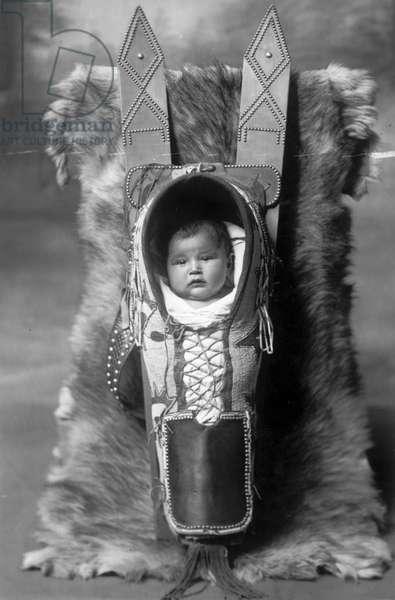 Comanche kid and carrier, Lawton, Oklahoma, c.1920-30 (b/w photo)