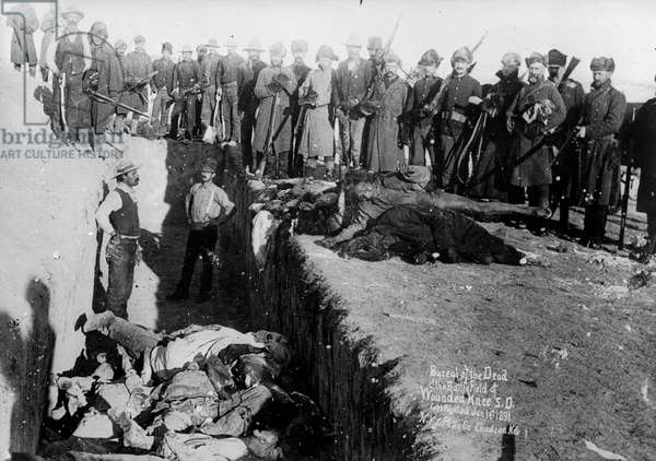 Bureal (burial) of the dead at the battlefield of Wounded Knee, South Dakota, 1891 (b/w photo)