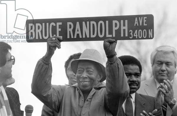 Bruce Randolph at street naming, 1984 or 1985 (b/w photo)