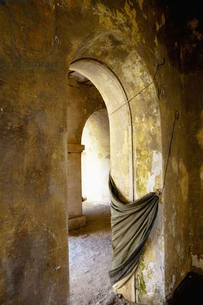 Fabric Draped from the Archway of a Weathered Concrete Wall, Dakar Senegal (photo)