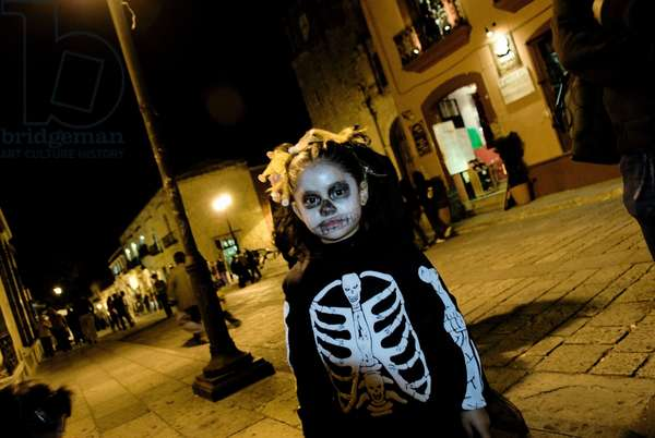 Little Girl Dressed As Skeleton For Mexican Day of the Dead, Mexico (photo)
