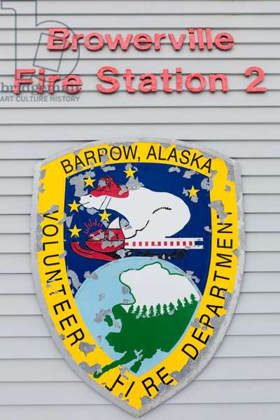 Exterior view of the badge and lettering on the wall of the Browerville Fire Station, Barrow, North Slope, Arctic Alaska, USA, Winter (photo)
