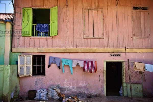 A Clothesline hanging outside of a House, Muara Pinang Sumatera Selatan Indonesia (photo)