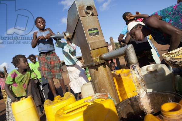 A Young Girl Pumps Clean Water from the Well, Manica, Mozambique, Africa (photo)
