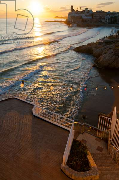 Sunset in the beautiful Sitges downtown, a village near to Barcelona, Sitges, Spain (photo)