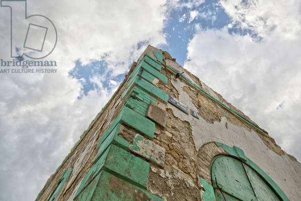 Low Angle View of the Corner of a Building with a Cloudy Sky Overhead, Jacmel, Haiti (photo)