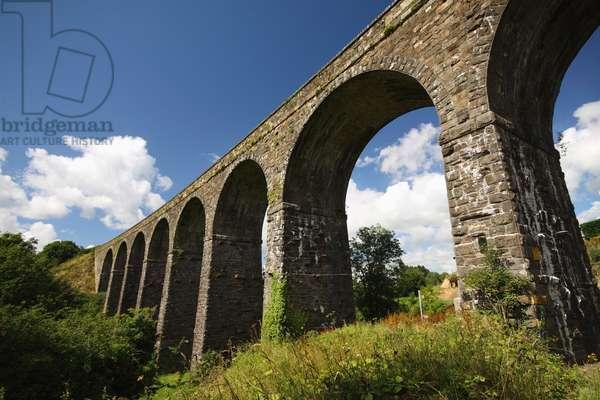 Arched Railway Bridge Running Through Kilmacthomas In Munster Region; Kilmacthomas, County Waterford, Ireland (photo)
