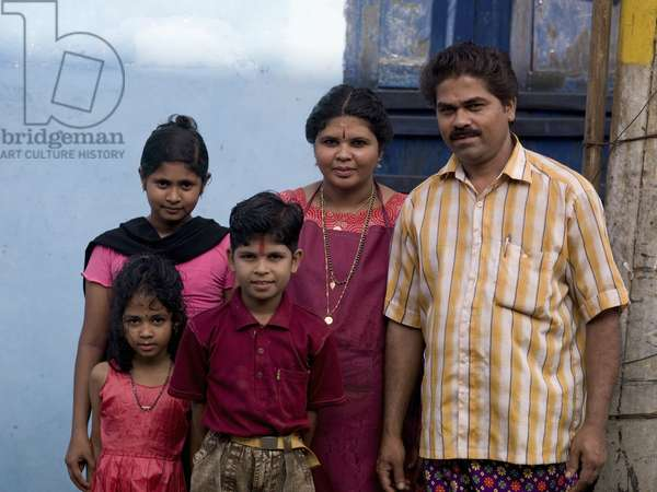 Portrait of Well Dressed Indian Family in front of Their Home, Kochi, Kerala, India (photo)