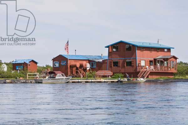 A View Of The Kvichak Lodge From The Water With Riverboats Docked On The Kvichak River; Bristol Bay Igiugig Alaska United States Of America (photo)