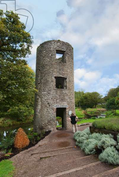 Tourist Looking At Round Tower; Blarney, County Cork, Ireland (photo)