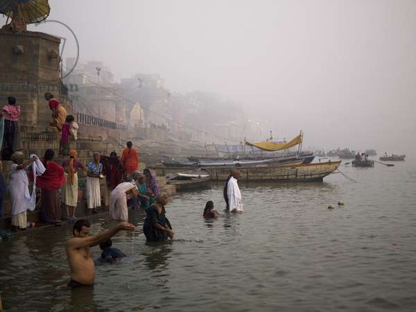 People bathing in the River Ganges, Varanasi, India, (photo)