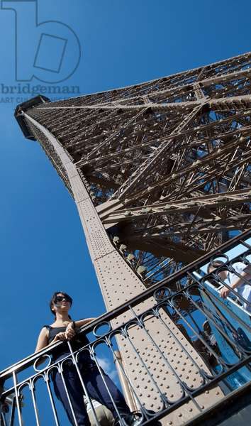 France, Woman enjoying view from Eiffel Tower, Paris (photo)