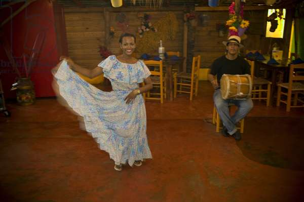Woman dancing Traditionally to a Drumbeat, Dominican Republic, West Indies, Caribbean (photo)