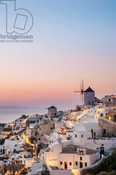 Whitewash buildings and windmill at dusk, Oia, Santorini, Greece (photo)