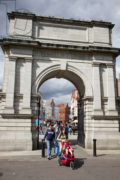 Pedestrians Walking Through An Arch And Across The Street; Dublin City County Dublin Ireland (photo)