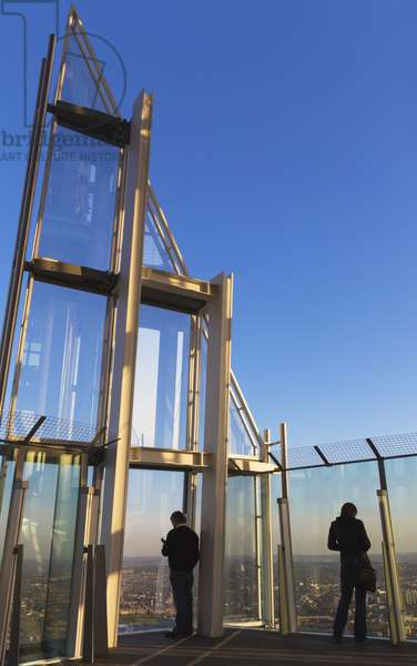 People looking out over London from the View from the Shard observation deck, London, England, UK  (photo)