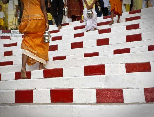 People walking up Steps that Have Been Painted in White and Red Stripes, Penang Malaysia (photo)