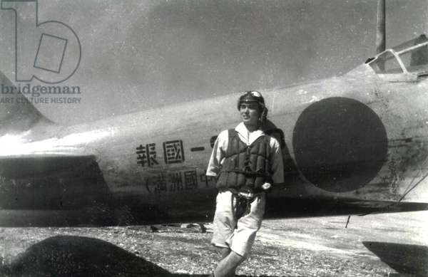 World War II,Japanese pilot poses by Zero fighter in the South Pacific