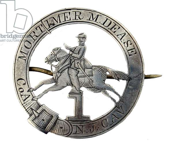 A silver Identification badge of - Mortimer M Dease Co A 1st NJVC 1863-1865