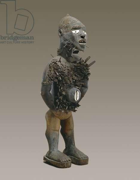 Nail Figure (nkisi n'kondi) Yombe, Congo c.1875 (wood with screws, nails, blades & cowrie shells)