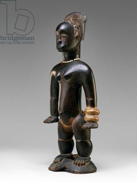 Standing female figure, Guro, Ivory Coast, 19th-20th century (wood & beads)