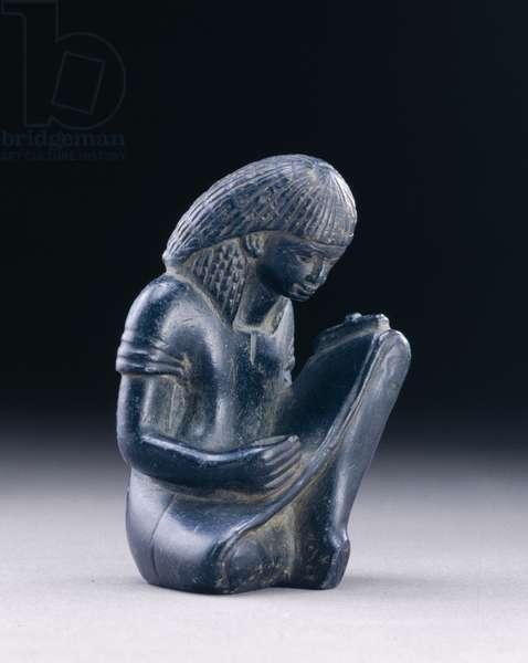 Seated scribe, New Kingdom, 1391-1353 BC (greywacke)