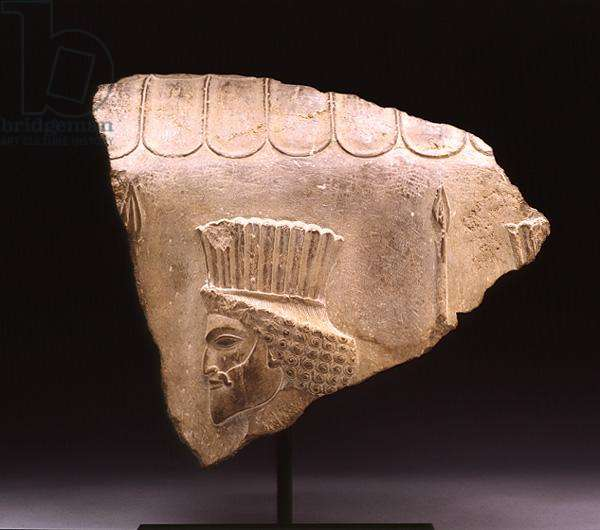 Fragment from a stair balustrade, detail depicting a Persian spearman wearing a feathered headdress, Achaemenid Dynasty (limestone)