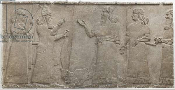 Carved relief of Tiglath-Pileser III receiving homage from a vanquished warrior, south-west palace, Nimrud (Kalah) Mesopotamian, Neo-Assyrian period, 745-727 BC (limestone)